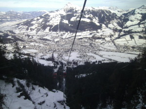 Skiing Kitzbuhel above a beautiful village.